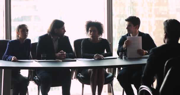 Multi ethnic employers team making hiring decision at job interview