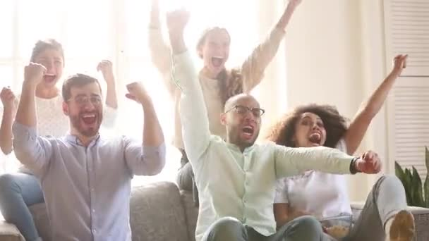 Overjoyed multicultural friends group football fans watching tv game
