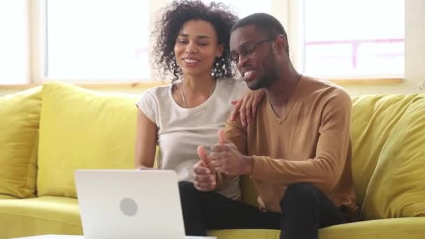 Happy African Young Couple Talking To Webcam Making Video Call