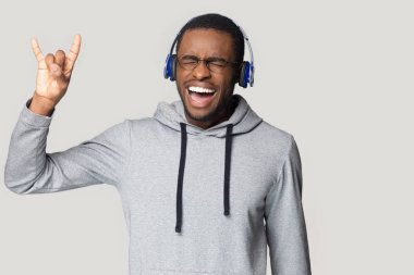 Crazy happy young african american male melomaniac keen on music.