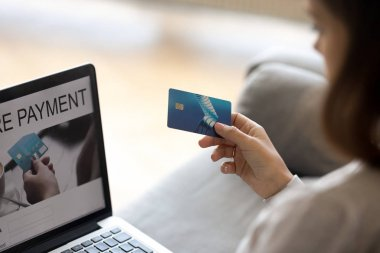 Close up of woman hold credit card using secure payment