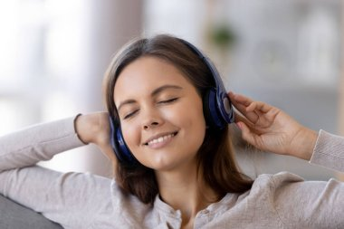 Close up of happy girl enjoy music in wireless headphones