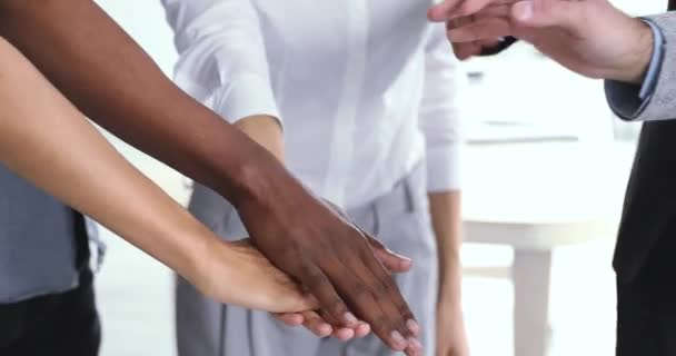 Corporate business team people stack hands together in pile, closeup