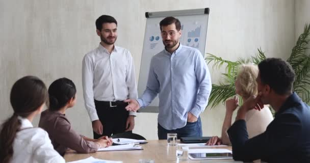 Best male company employee being rewarded at team meeting