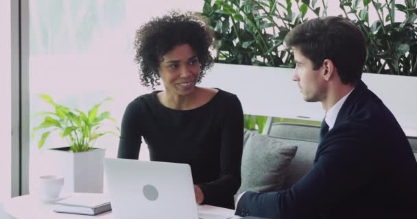 African businesswoman sales manager consulting businessman client offering contract