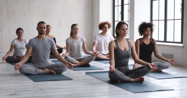 Group of people meditating improve inner harmony mind body relaxation