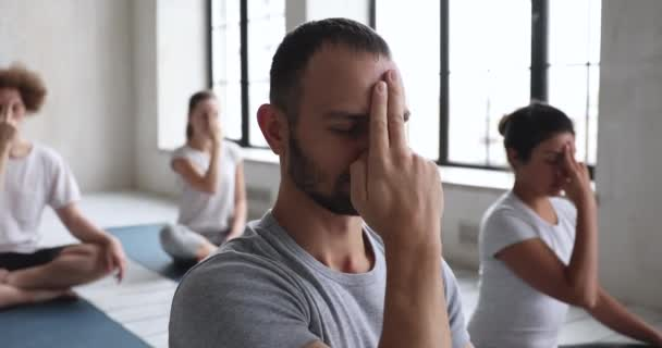 Group of multiracial people do opening the third eye meditation