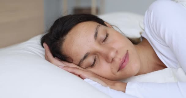 Serene calm young mixed race woman sleeping well.