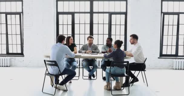 Confident male executive speak at group meeting modern office table