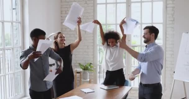 Happy multiracial business people having fun in office.