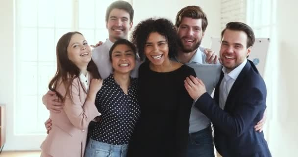 Cheerful successful multicultural dream team executives group portrait