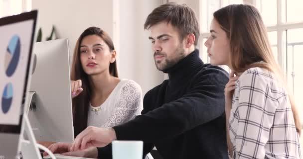 Focused business analysts team listening male leader analyze pc data