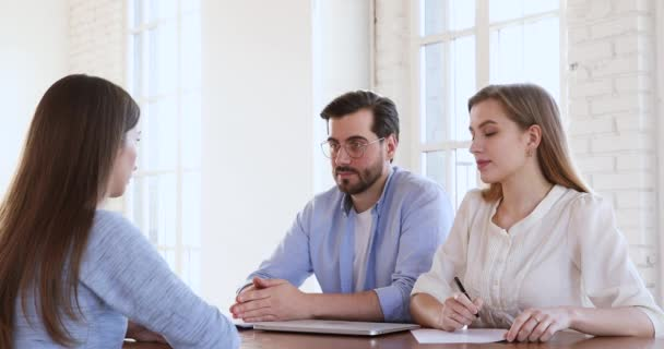 Two recruiters hr managers interviewing handshaking young female job candidate