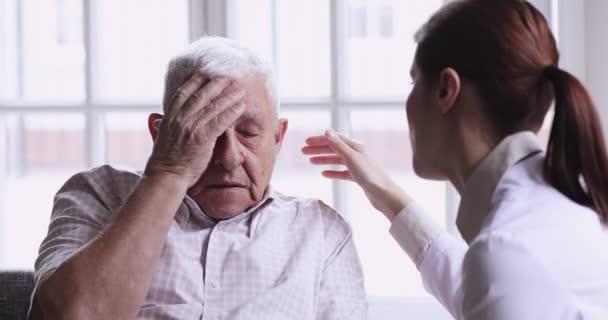 Depressed senior old grandpa get psychological support from caring doctor