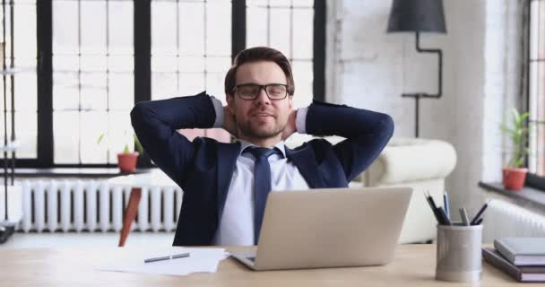 Successful businessman relaxing satisfied with work well done at workplace