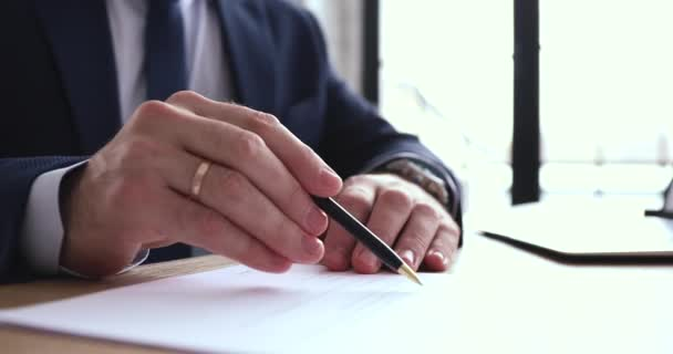 Businessman checking, signing legal document concept, close up view