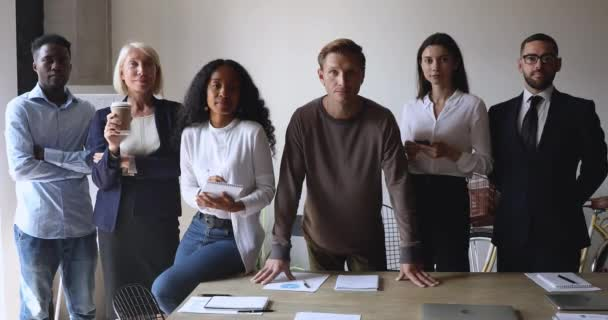 Group of different ages multiracial business people in modern office.