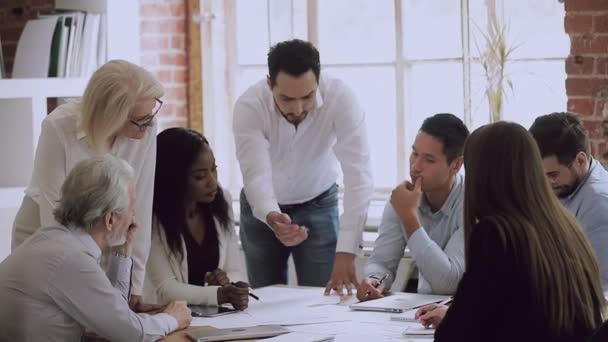 Business team people brainstorm solve mistakes in paperwork at meeting