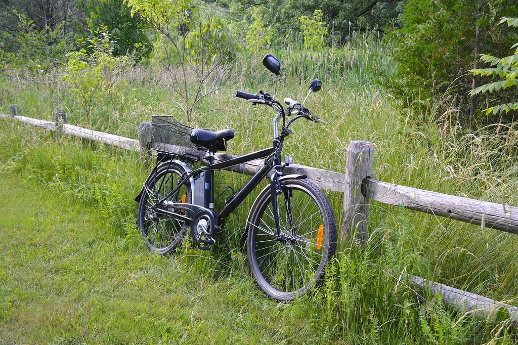 Electric bicycle on the wood fence