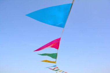 Triangle flags hanging on the rope