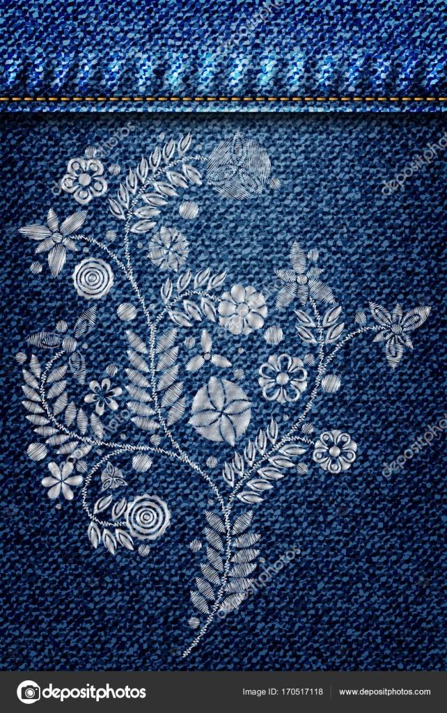 6664a1f664 Argento pizzo fiori ricamati su jeans o denim blu sfondo ...