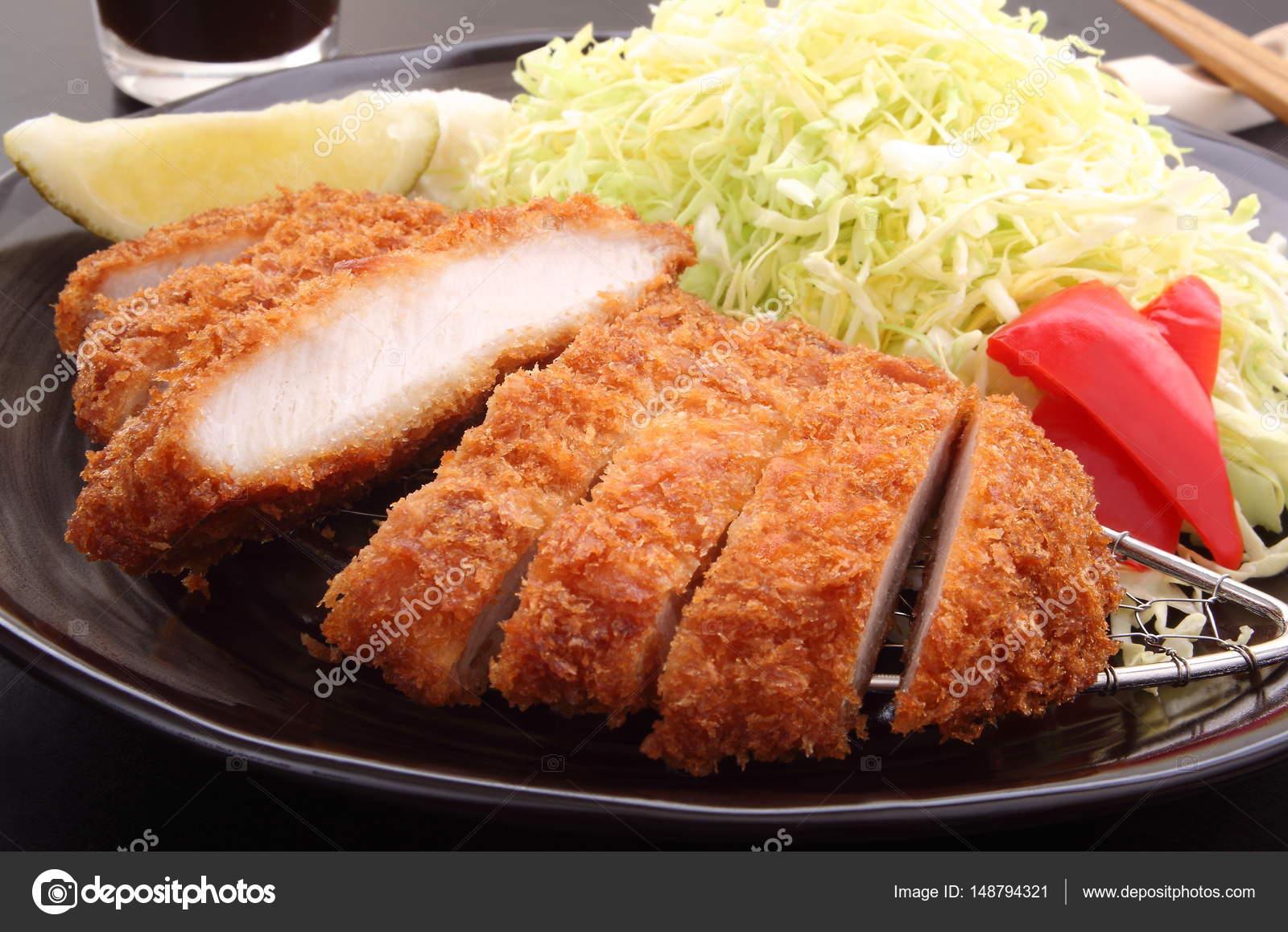 Deep Fried Pork Loin Cutlet With Salad And Lemon Japanese Food Stock Photo