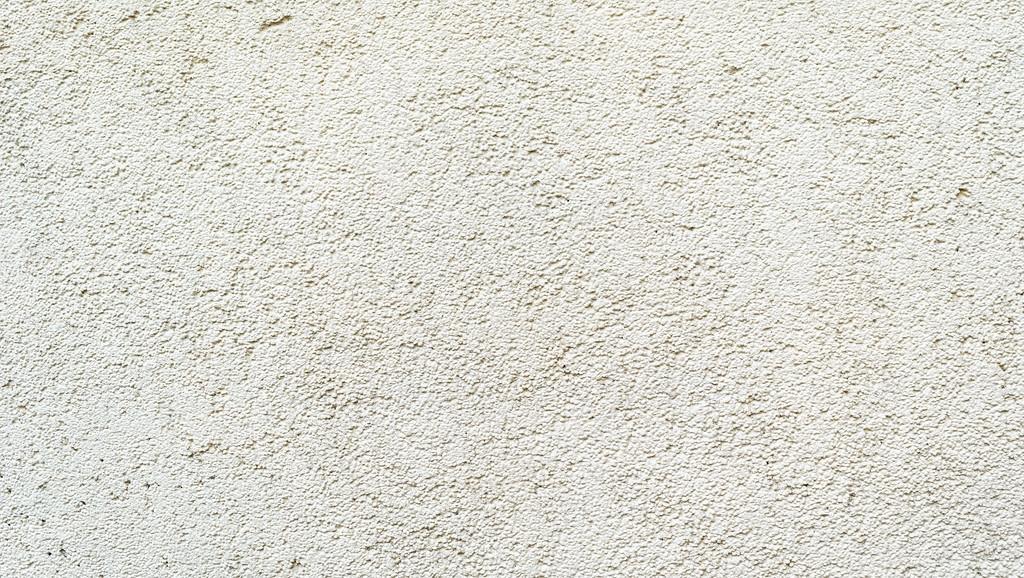 Superficie del muro rivestito con intonaco strutturato for Intonaco rustico