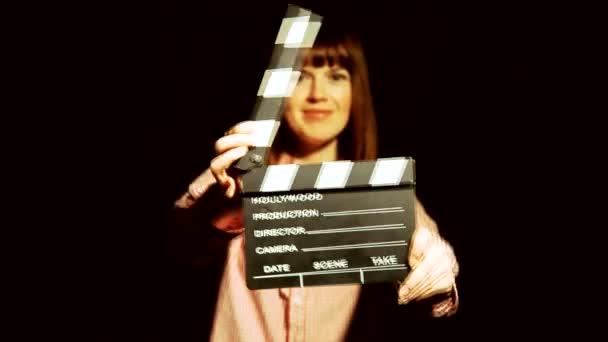Dreharbeiten für einen Film. sie ohrfeigt einen Filmklatscher