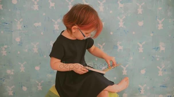 A book for children. A child reads a children's book