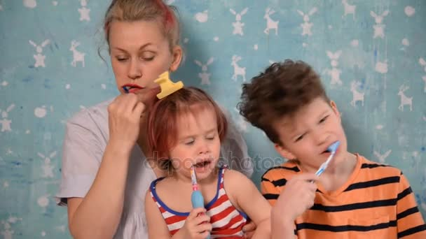 Toothbrush. Mom, son and daughter brush their teeth
