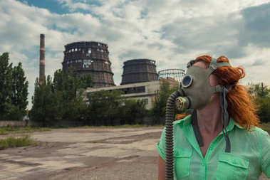 Global warming. A girl in a gas mask on the background of a fact