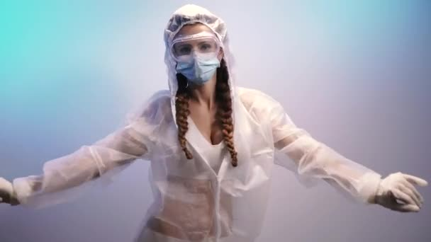 Virus. A woman in a protective antivirus suit is dancing.