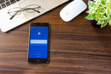 BANGKOK ,THAILAND - January 15, 2017 : Login Screen Facebook icons on Apple iPhone 6. largest and most popular social networking site in the world