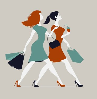 Women with shopping bags. Two young fashionable women walking in