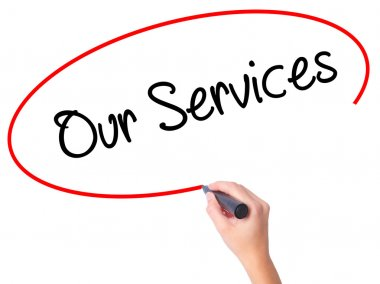 Women Hand writing Our Services with black marker on visual scre
