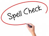 Fotografie Women Hand writing Spell Check  with black marker on visual scre