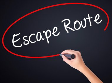 Woman Hand Writing Escape Route with a marker over transparent b