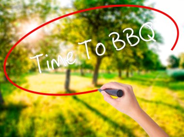 Woman Hand Writing Time To BBQ with a marker over transparent bo