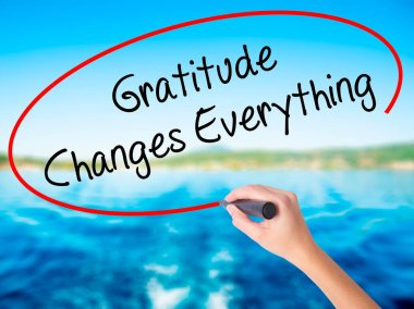 Woman Hand Writing Gratitude Changes Everything with a marker ov