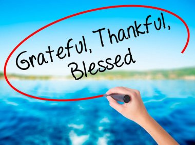 Woman Hand Writing  Grateful Thankful Blessed with a marker over