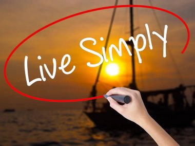 Woman Hand Writing Live Simply with a marker over transparent bo