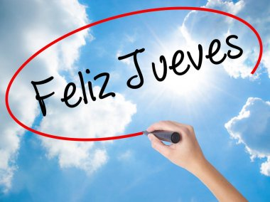 Woman Hand Writing Feliz Jueves (Happy Thursday In Spanish) with