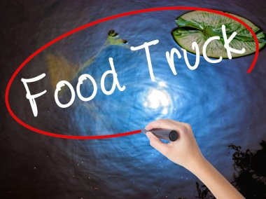 Woman Hand Writing Food Truck with marker over transparent board