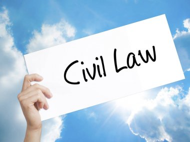 Civil Law Sign on white paper. Man Hand Holding Paper with text.