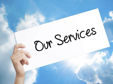 Our Services Sign on white paper. Man Hand Holding Paper with te
