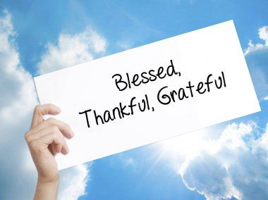 Blessed Thankful Grateful Sign on white paper. Man Hand Holding