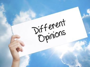 Different Opinions Sign on white paper. Man Hand Holding Paper w