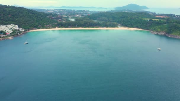 Aerial view of beautiful tropical beach and sea with trees on island for travel and vacation. Nai Han Beach Thailand