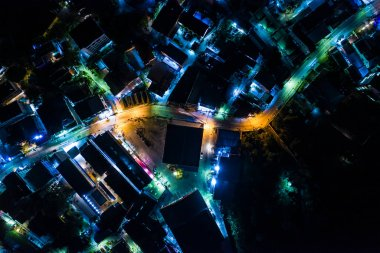 Bright night time illumination with traffic on street. Many moto