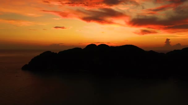 Amazing colorful sunset behind an island. Ko Phi Phi Thailand at dusk. Aerial